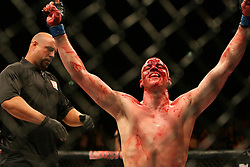 A bloody and battered Stefan Struve of the Netherlands celebrates victory. Cologne, Germany,  Ultimate Fighting Championship.