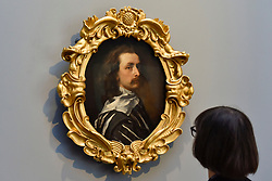 "© Licensed to London News Pictures. 06/10/2017. London, UK.   A staff member views ""Self-portrait"", c1640, by Sir Anthony Van Dyck which has returned to the National Portrait Gallery following a three year nationwide tour and is on display alongside a new Julian Opie artwork. Photo credit : Stephen Chung/LNP"
