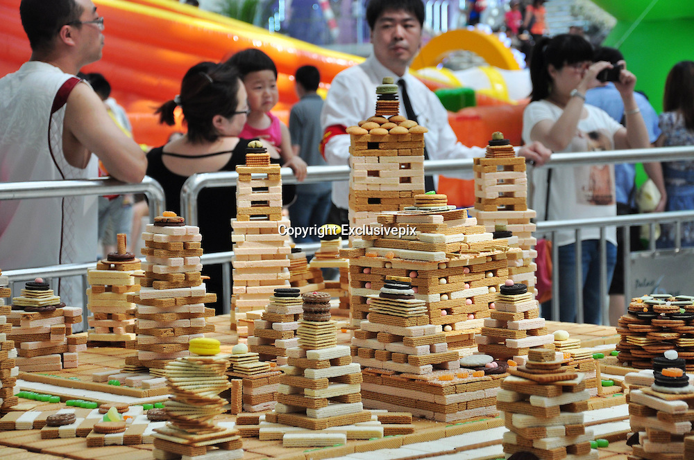 SHENYANG, CHINA - JUNE 23: (CHINA OUT) <br /> <br /> Biscuit City In Shenyang, China<br /> Photo shows buildings made of biscuits at a shopping mall on June 23, 2013 in Shenyang, Liaoning Province of China. Workers spent three days building a replica of Shenyang city with biscuits, waffles and sugars. The biscuit city includes some famous buildings in Shenyang city, for example Zhaoling Tomb, Shenyang Railway Station, Fang Yuan Building, Wulihe Stadium and so on. And the city will be distributed to customers after exhibition. <br /> ©Exclusivepix