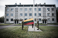 Soldiers raise the Lithuanian flag inside Rukla's base.