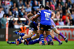 Jannes Kirsten of Exeter Chiefs is tackled by Simone Elrick of Bath Rugby - Mandatory by-line: Ryan Hiscott/JMP - 21/09/2019 - RUGBY - Sandy Park - Exeter, England - Exeter Chiefs v Bath Rugby - Premiership Rugby Cup