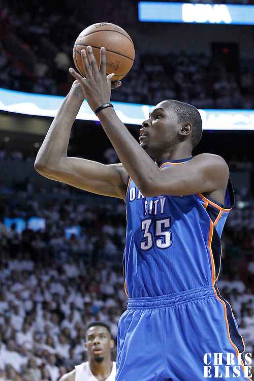 21 June 2012: Oklahoma City Thunder small forward Kevin Durant (35) takes a jumpshot during the Miami Heat 121-106 victory over the Oklahoma City Thunder, in Game 5 of the 2012 NBA Finals, at the AmericanAirlinesArena, Miami, Florida, USA. The Miami Heat wins the series 4-1.