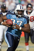 NASHVILLE, TN - OCTOBER 29:  Tony Brown #97 of the Tennessee Titans returns a fumble for a touchdown against the Houston Texans at LP Field on October 29, 2006 in Nashville, Tennessee. The Titans defeated the Texans 28 to 22. (Photo by Wesley Hitt/Getty Images)***Local Caption***Tony Brown