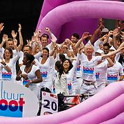NLD/Amsterdam/20100807 - Boten tijdens de Canal Parade 2010 door de Amsterdamse grachten. De jaarlijkse boottocht sluit traditiegetrouw de Gay Pride af. Thema van de botenparade was dit jaar Celebrate, Cultturboot