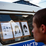 A police van is parked at the Cherkizovo market in eastern Moscow soon after .an explosion killed 10 people, including two children, and injuring more than 40..Prosecutors said the attack was likely linked to organized crime, though terrorism could not be ruled out..The explosion crashed the roof of around 100 sq meters and triggering the fire.