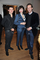 Left to righr, the HON.JASSET ORMSBY-GORE, JASMINE GUINNESS and her husband GAWAIN RAINEY at the launch of the Krug Happiness Exhibition at The Royal Academy, 6 Burlington Gardens, London on 12th December 2011.
