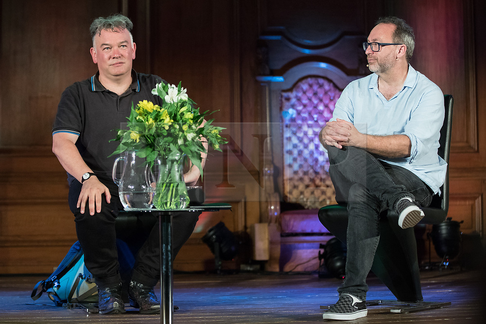 """© Licensed to London News Pictures. 05/07/2017. London, UK. Comedian STEWART LEE in conversation with Wikipedia founder JIMMY WALES at the Emmanuel Centre in Westminster . The event , titled """" Heroes """" and organised by the School of Life , sees a guest interviewer (Wales) select and interviews someone whose work they admire (Lee) . Stewart Lee is currently touring his Content Provider show and Jimmy Wales is in the process of setting up news website WikiTribune . Photo credit: Joel Goodman/LNP"""