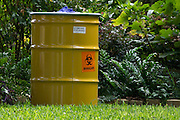 A hazardous waste barrel in the yard outside an apartment where a second Ebola patient has been reported in Dallas, Texas on October 12, 2014. (Cooper Neill for The New York Times)