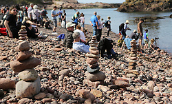 European Stone Stacking 2019 21 April 2019; people enjoy the sunshine and viewing the sculptures during European Stone Stacking 2019 at Eye Cave Beach, Dunbar.<br /> <br /> (c) Chris McCluskie | Edinburgh Elite media