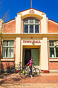 Cyclist at the Pleasant Point town hall, Canterbury, South Island, New Zealand