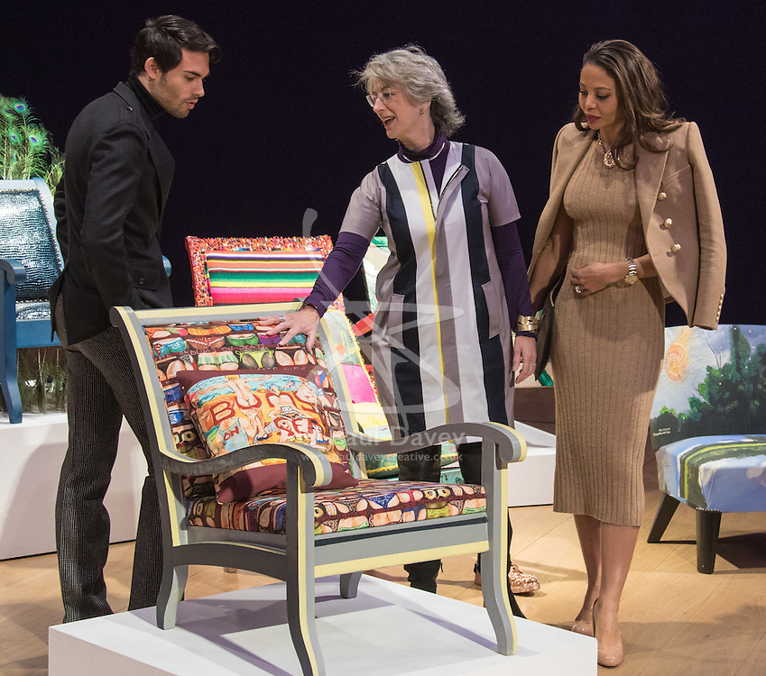 """Bonhams, London, February 29th 2016. Made In Chelsea's Mark Francis Vandelli and Emma, Viscountess Weymouth of Longleat (right) with actress Maureen Lipman and the chair she created during a photocall for """"Sitting Pretty"""" featuring unique, hand painted and upholstered chairs made by 30 celebrities and artists, at Bonhams ahead of their auction in support of a leading AIDS charity, CHIVA Africa.<br /> ©Paul Davey<br /> FOR LICENCING CONTACT: Paul Davey +44 (0) 7966 016 296 paul@pauldaveycreative.co.uk"""