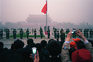 The lowering of the Chinese flag in a vail of smog in front of the forbidden city. Seven of the ten most polluted cities in the world are located in China, due primarily to the country's dependence on coal for energy and dilapidated heavy industries.<br /> Beijing, China. 05/11/2005<br /> Photo &copy; J.B. Russell