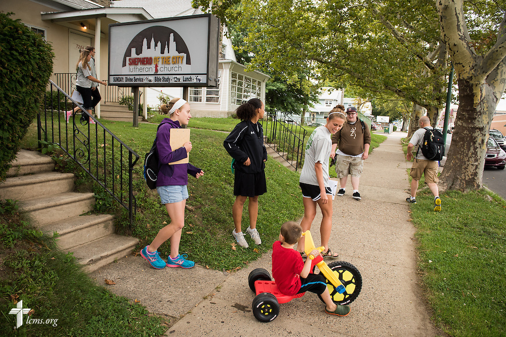 Knox DeGroot rides along with participants of the 2014 Youth Corps pilot project as they head into different neighborhoods outside Shepherd of the City Lutheran Church on Tuesday, August 12, 2014, in Philadelphia, Pa. LCMS Communications/Erik M. Lunsford