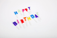 High angle view of birthday candles against white background