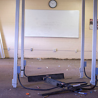 A classroom at Rehoboth High School in Rehoboth is stripped of all supplies and the baseboards are ripped up and stacked in a corner Friday following a water line break under the building.