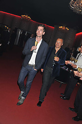 Left to right, ? and GRAHAM NORTON at a party hosted by Roberto Cavalli to celebrate his new Boutique's opening at 22 Sloane Street, London followed by a party at Battersea Power Station, London SW8 on 17th September 2011.