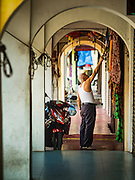 17 NOVEMBER 2016 - GEORGE TOWN, PENANG, MALAYSIA:  A shop owner sets out his merchandise in a shop in George Town, Penang, Malaysia. George Town is a UNESCO World Heritage city and wrestles with maintaining its traditional lifestyle and mass tourism.       PHOTO BY JACK KURTZ