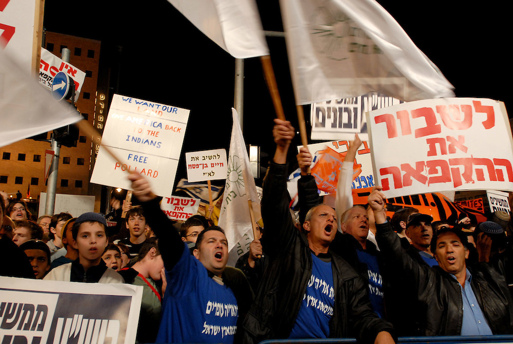 Right wing activists participate in a demonstration protest against the Israeli government's decision to freeze construction of new hoses in Jewish settlements in the center of Jerusalem, December 09, 2009. Over 10,000 right-wing protesters gathered on Wednesday in Paris Square in Jerusalem near the Prime Minister's residence to demonstrate against the temporary settlement freeze.