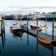 Small fishing boats and a rowing dory in Gloucester, MA