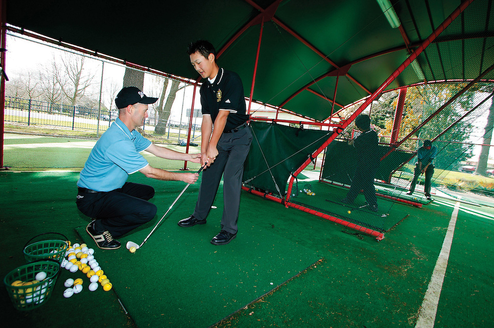 Rotorua Boys High School golf academy dircetor Mark Lavery giving coaching tips to 15 year old  Danny Lee at the school's driving range, Rotorua, New Zealand, November 09, 2005.  Lee is one of the many success stories from the school's golf  academy. Credit:SNPA / Rob Tucker