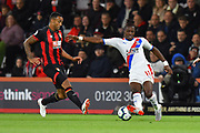Callum Wilson (13) of AFC Bournemouth and Wilfried Zaha (11) of Crystal Palace during the Premier League match between Bournemouth and Crystal Palace at the Vitality Stadium, Bournemouth, England on 1 October 2018.