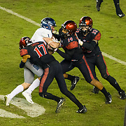 18 November 2017:  The San Diego State football team hosts Nevada Saturday night. Nevada Wolf Pack wide receiver McLane Mannix (1) is gang tackled by San Diego State Aztecs cornerback Ron Smith (17), safety Tariq Thompson (14) and safety Parker Baldwin (33) in the third quarter. The Aztecs beat the Wolf Pack 42-23 at SDCCU stadium. <br /> www.sdsuaztecphotos.com