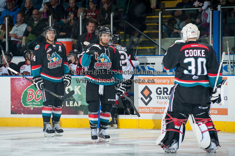 KELOWNA, CANADA - OCTOBER 19: Madison Bowey #4 and Tyrell Goulbourne #12 celebrate a goal with Jordon Cooke #30 of the Kelowna Rockets on October 19, 2013 at Prospera Place in Kelowna, British Columbia, Canada.   (Photo by Marissa Baecker/Shoot the Breeze)  ***  Local Caption  ***