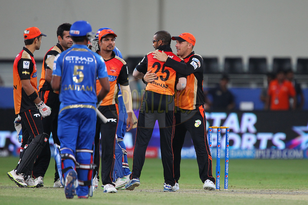 Players shake hands after the match during match 20 of the Pepsi Indian Premier League Season 2014 between the Mumbai Indians and the Sunrisers Hyderabad held at the Dubai International Stadium, Dubai, United Arab Emirates on the 30th April 2014<br /> <br /> Photo by Ron Gaunt / IPL / SPORTZPICS
