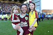 Burnley midfielder George Boyd (21)  and two of his children during the Sky Bet Championship match between Burnley and Queens Park Rangers at Turf Moor, Burnley, England on 2 May 2016. Photo by Simon Davies.