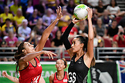 11th April 2018, Gold Coast Convention and Exhibition Centre, Gold Coast, Australia; Commonwealth Games day 7; Netball, England versus New Zealand; Geva Mentor of England  attempts to block the shot from Maria Folau of New Zealand