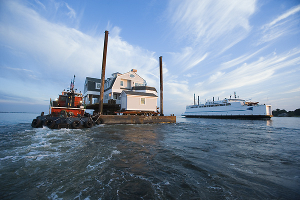 A newly built summer home being moved by tug, to a small island off the coast of CT.