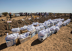 "09/03/2014.  The remains of 45 victims exhumed from mass graves in the city of Hargeisa, Somaliland were re buried today in an Islamic ceremony.  The victims were part of an excavation of the graves as part of an ongoing project by international students from Peruvian based forensic anthropology team Equipo Peruano de Antropologia Forense (EPAF).  <br /> <br /> ""Even if you are poor you deserve to be buried as a human being, not thrown into a hole like an animal."" Commented Jose Barayber, head of the team of forensic students attending the ceremony.  <br /> <br /> There may be as many as 200 graves in the city with an estimated 50,000 to 60,000 killed.  The atrocity took place between 1988 and 1991 by former dictator Mohamed Siad Barre.  According to the Somaliland War Crimes Investigation Committee (WCIC) the massacre began after a tribe known as the Isaaq began an uprising against Biarre's regime.  He responded by ordering the execution of all members of this clan. Alison Baskerville/LNP"