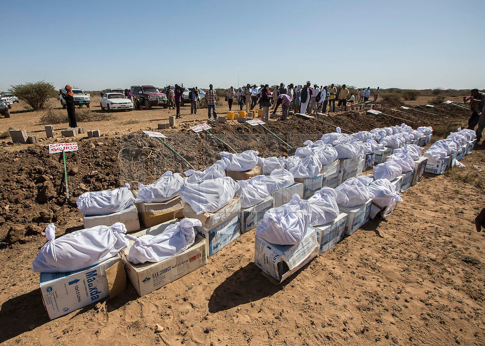 """09/03/2014.  The remains of 45 victims exhumed from mass graves in the city of Hargeisa, Somaliland were re buried today in an Islamic ceremony.  The victims were part of an excavation of the graves as part of an ongoing project by international students from Peruvian based forensic anthropology team Equipo Peruano de Antropologia Forense (EPAF).  <br /> <br /> """"Even if you are poor you deserve to be buried as a human being, not thrown into a hole like an animal."""" Commented Jose Barayber, head of the team of forensic students attending the ceremony.  <br /> <br /> There may be as many as 200 graves in the city with an estimated 50,000 to 60,000 killed.  The atrocity took place between 1988 and 1991 by former dictator Mohamed Siad Barre.  According to the Somaliland War Crimes Investigation Committee (WCIC) the massacre began after a tribe known as the Isaaq began an uprising against Biarre's regime.  He responded by ordering the execution of all members of this clan. Alison Baskerville/LNP"""