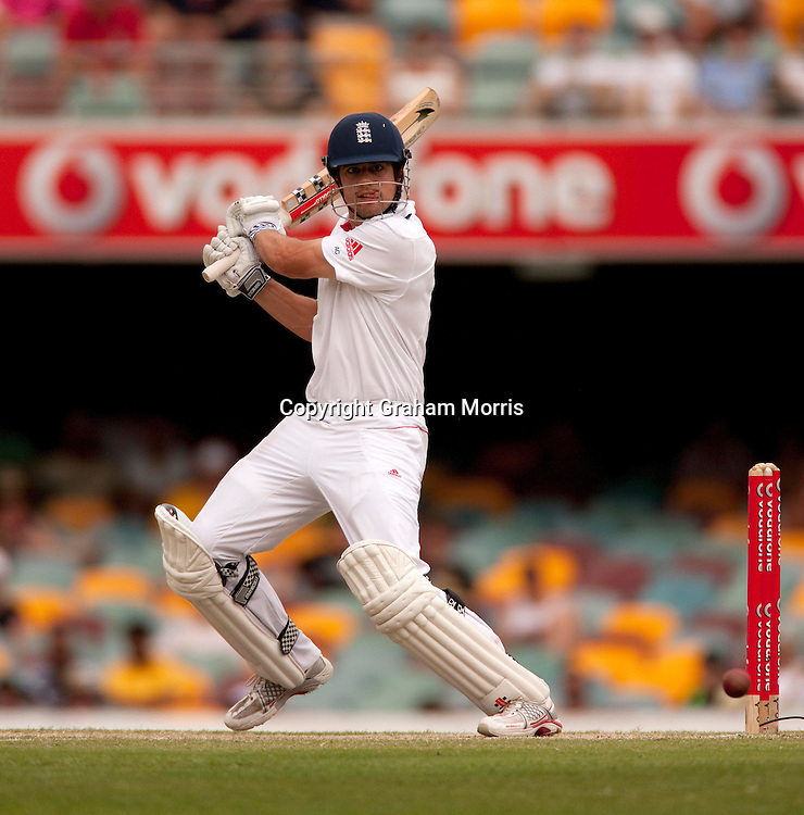 Alastair Cook (tongue out) cuts Peter Siddle to the boundary to bring up his century in the first Ashes Test Match between Australia and England at the Gabba, Brisbane. Photo: Graham Morris (Tel: +44(0)20 8969 4192 Email: sales@cricketpix.com) 28/11/10