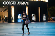Young woman in front of Giorgio Armani shop in ION Orchard (Singapore)