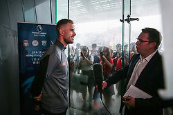 HONG KONG, CHINA - Monday, July 17, 2017: Liverpool's captain Jordan Henderson speaks with Sky Sports' Vinny O'Connor as the team arrive at the Ritz-Carlton Hotel in Kowloon, Hong Kong, ahead of the Premier League Asia Trophy 2017. (Pic by FA Premier League/Pool/Propaganda)