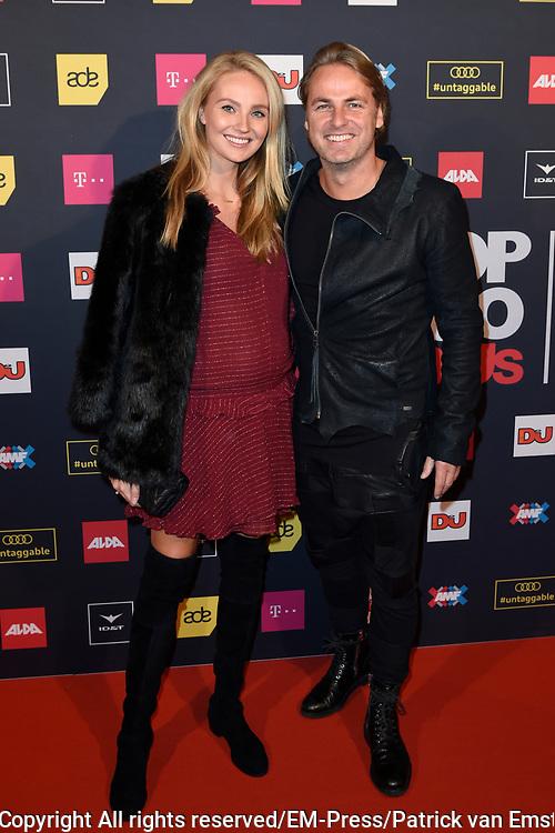 AMF Red Carpet Top 100 DJs Award Show in the Heineken Music Hall.<br /> <br /> On the photo:  John Ewbank and partner Kelly Weekers ( zwanger )
