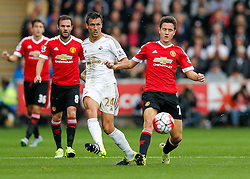 Jack Cork of Swansea City and Ander Herrera of Manchester United compete for the ball - Mandatory byline: Rogan Thomson/JMP - 07966 386802 - 30/08/2015 - FOOTBALL - Liberty Stadium - Swansea, Wales - Swansea City v Manchester United - Barclays Premier League.