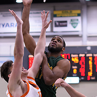 4th year forward Brian Ofori (11) of the Regina Cougars during the 5th year night on February  11 at Centre for Kinesiology, Health and Sport. Credit: Arthur Ward/Arthur Images