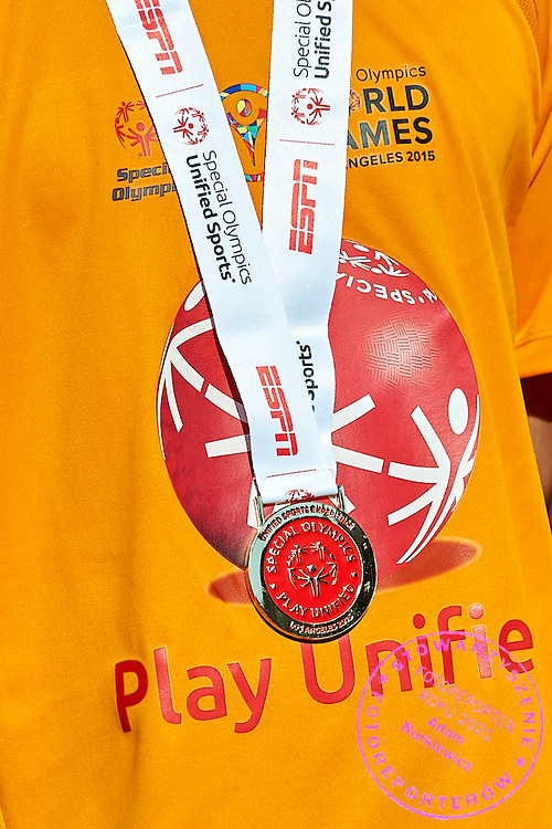 Gold medal hang while Unified Sports Experience Football 5-a-side match during fourth day of the Special Olympics World Games Los Angeles 2015 on July 28, 2015 at Intramural Fields UCLA (University of California, Los Angeles) in Los Angeles, USA.<br /> <br /> USA, Los Angeles, July 28, 2015<br /> <br /> Picture also available in RAW (NEF) or TIFF format on special request.<br /> <br /> For editorial use only. Any commercial or promotional use requires permission.<br /> <br /> Adam Nurkiewicz declares that he has no rights to the image of people at the photographs of his authorship.<br /> <br /> Mandatory credit:<br /> Photo by &copy; Adam Nurkiewicz / Mediasport