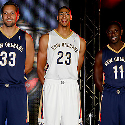 Aug 1, 2013; Metairie, LA, USA; New Orleans Pelicans players Ryan Anderson (33) and Anthony Davis (23) and Jrue Holiday (11) during a uniform unveiling at the team practice facility. Mandatory Credit: Derick E. Hingle-USA TODAY Sports