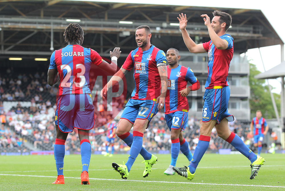 Pape Souare ( L ) of Crystal Palace celebrates with Damien Delaney ( C ), and Scott Dann ( R ) after he scores to make it 1-1 - Mandatory by-line: Paul Terry/JMP - 07966386802 - 01/08/2015 - SPORT - FOOTBALL - Fulham,England - Craven Cottage - Fulham v Crystal Palace - Pre-Season Friendly
