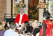 "Santa Claus (aka Jerry Francis of Dayton) talks to daughter Krystal (right, aka Alisha McDarris) during Mayhem & Mystery's production of ""I'll Be Home Shopping for Christmas"" at the Spaghetti Warehouse in downtown Dayton, Monday, November 9, 2009."