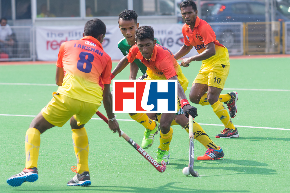 Hockey World League - Passing, supporting and reinforcing. Sri Lanka players are so good in match that left their Myanmar opponent in desperation. The final score of 7-0 just reflecting their superiority. Photo at Sengkang Hockey Stadium, 09/04/2016. (Photo by Huang Xiaolong/Sport Singapore)