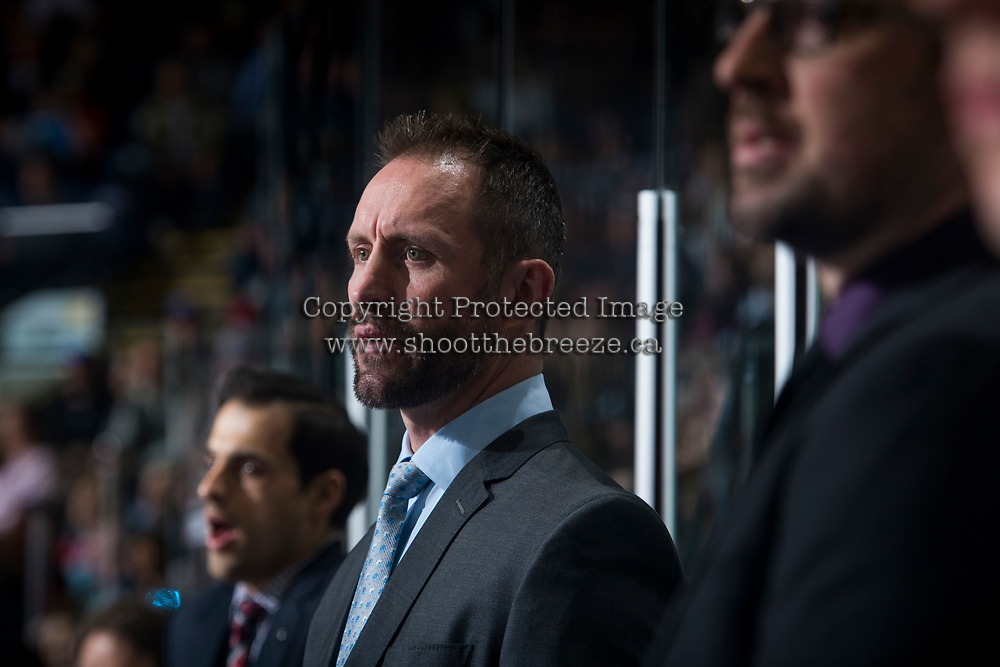 KELOWNA, CANADA - MARCH 31: Kelowna Rockets' head coach Jason Smith stands on the bench against the Kamloops Blazers on March 31, 2017 at Prospera Place in Kelowna, British Columbia, Canada.  (Photo by Marissa Baecker/Shoot the Breeze)  *** Local Caption ***