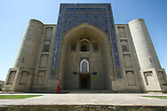 A woman entering a 400 y.o. Khanaka - a building designed specifically for gatherings of a Sufi brotherhood and as a place for spiritual retreat and character reformation. It is one of the main sights in Bukhara.