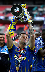 Jake Reeves of AFC Wimbledon pours Champagne over himself out of the Sky Bet League Two Playoff Trophy - Mandatory by-line: Robbie Stephenson/JMP - 30/05/2016 - FOOTBALL - Wembley Stadium - London, England - AFC Wimbledon v Plymouth Argyle - Sky Bet League Two Play-off Final