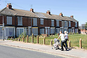 2 July 2009: Gateway board members who had a tour of the Nasa area of Hull..A young couple with a pram walk past boarded up houses near Hathorn Avenue..Picture:Sean Spencer/Hull News & Pictures 01482 210267/07976 433960.High resolution picture library at http://www.hullnews.co.uk.©Sean Spencer/Hull News & Pictures Ltd.