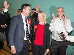 © Licensed to London News Pictures . 10/10/2014 . Heywood , UK . Labour candidate Liz McInnes and her team cheer as the result is declared . The count at the Heywood and Middleton by-election , following the death of sitting MP Jim Dobbin . Photo credit : Joel Goodman/LNP