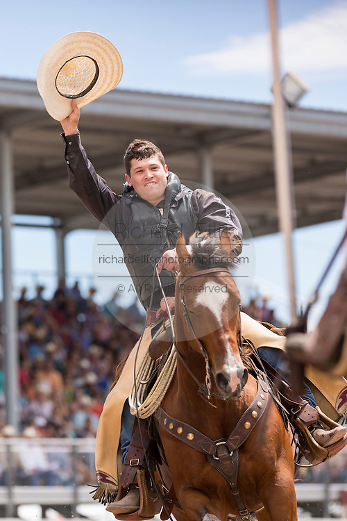 Bareback rider Tanner Aus of Granite Falls, Minnesota celebrates after winning the Bareback Championships at the Cheyenne Frontier Days rodeo in Frontier Park Arena July 26, 2015 in Cheyenne, Wyoming. Frontier Days celebrates the cowboy traditions of the west with a rodeo, parade and fair.